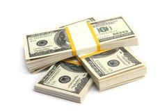 Dinero - pila de dólares imagenes de archivo
