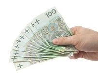 Dinero polaco a disposición. Camino de recortes incluido. Fotografía de archivo