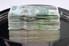 Dinero polaco en la bandeja Imagen de archivo libre de regalías