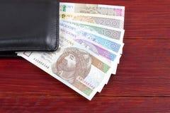 Dinero polaco en la cartera negra