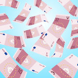 Dinero que cae del cielo El caer euro de 10 billetes de banco Fotografía de archivo