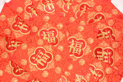 Dinero que contiene de papel rojo como regalo Foto de archivo libre de regalías