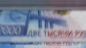 """Dinero que cuenta el down†de la máquina """"2000 rublos rusas stock de ilustración"""