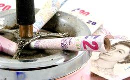 Dinero que fuma Foto de archivo libre de regalías