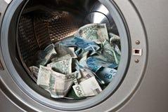 Dinero que lava plancha Foto de archivo libre de regalías