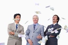 Dinero que llueve abajo en businessteam Fotos de archivo libres de regalías