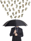 Dinero que llueve abajo en una persona Fotografía de archivo