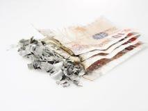 Dinero quemado Imagen de archivo libre de regalías