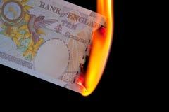 Dinero a quemar Fotografía de archivo