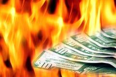 Dinero a quemar Fotografía de archivo libre de regalías
