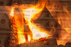 Dinero a quemar Foto de archivo libre de regalías