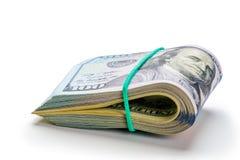 Dinero Rodado en un tubo de cientos dólares foto de archivo libre de regalías