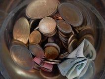 Dinero salvado Aislado en blanco Imagen de archivo