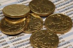 Dinero sobre el periódico Imagenes de archivo
