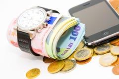 Dinero, teléfono y reloj Fotos de archivo libres de regalías