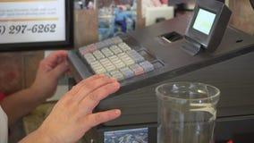 Dinero tomado en la caja registradora almacen de metraje de vídeo