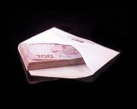 Dinero ucraniano en un sobre Foto de archivo libre de regalías