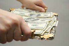 Dinero a una bandeja Foto de archivo libre de regalías