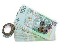 Dinero y ahorros. Pila de billetes de banco del zloty del pulimento 100's Imagen de archivo