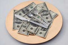 Dinero y alimento Fotos de archivo
