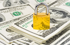 Dinero y bloqueo Foto de archivo