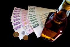 Dinero y botella Imagen de archivo libre de regalías