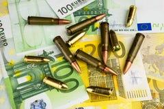 Dinero y bullets4 Fotos de archivo libres de regalías