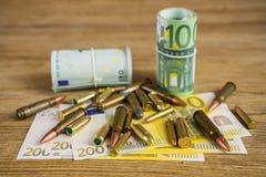 Dinero y bullets2 Fotos de archivo libres de regalías