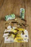 Dinero y bullets3 Imagen de archivo libre de regalías