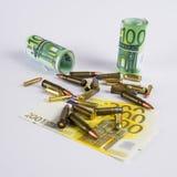 Dinero y bullets6 Imagen de archivo libre de regalías