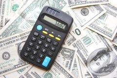 Dinero y calculadora Foto de archivo libre de regalías