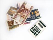 Dinero y calculadora Fotos de archivo libres de regalías