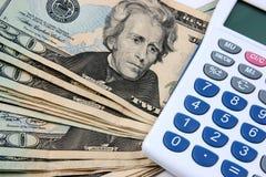 Dinero y calculadora Imagenes de archivo