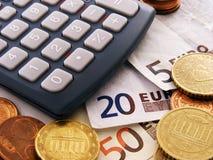 Dinero y calculadora euro Fotos de archivo
