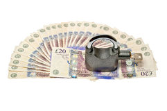 Dinero y candado - concepto 02 de la seguridad Foto de archivo libre de regalías