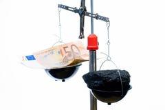 Dinero y carbón Imagen de archivo libre de regalías
