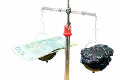 Dinero y carbón Foto de archivo