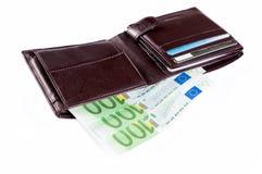 Dinero y cartera Fotos de archivo