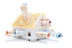 Dinero y casa Imágenes de archivo libres de regalías