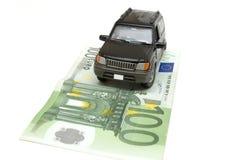 Dinero y coche Imágenes de archivo libres de regalías