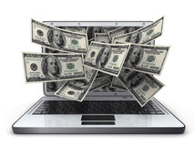 Dinero y computadora portátil Fotos de archivo libres de regalías