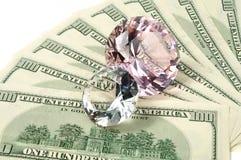 Dinero y diamantes Fotos de archivo