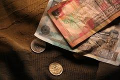 Dinero y dinero en circulación Foto de archivo libre de regalías