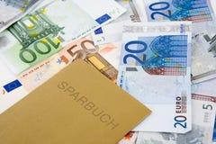 Dinero y libreta de banco euro Imagenes de archivo