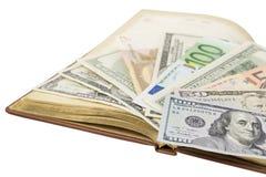 Dinero y libro Fotografía de archivo libre de regalías