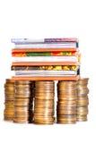 Dinero y libros imagen de archivo
