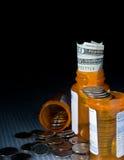 Dinero y medicamentos de venta con receta Fotografía de archivo