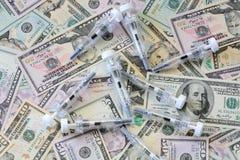 Dinero y medicina Fotografía de archivo libre de regalías