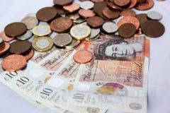 Dinero y monedas ingleses Foto de archivo