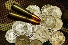 Dinero y munición Imagen de archivo libre de regalías